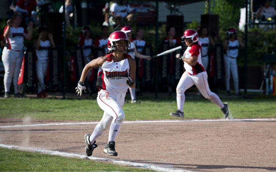 Kaiserslautern's Hien Huynh runs to first during the DODEA-Europe Division I softball championship at Ramstein Air Base, Germany, on Saturday, May 26, 2018.