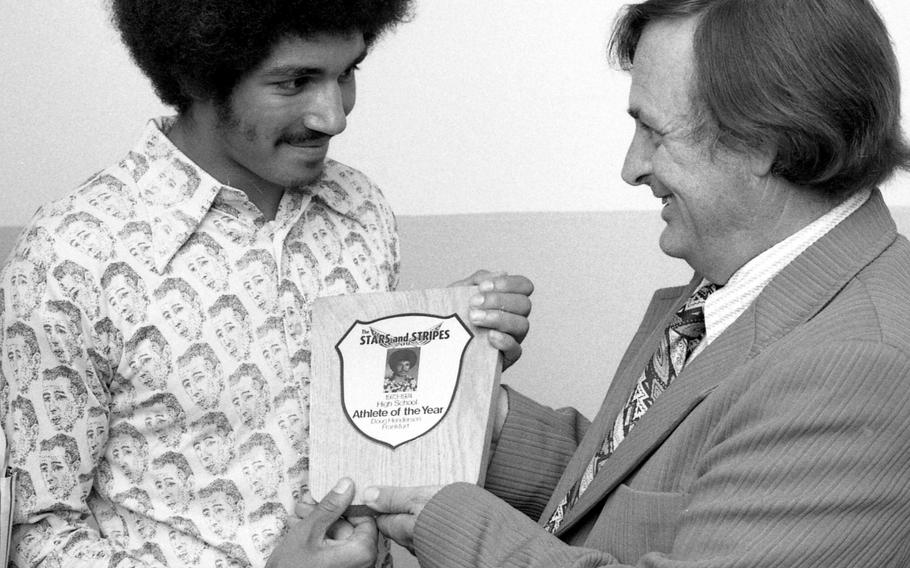 Ben Abrams, right, presents Frankfurt High School's Doug Henderson with the Stars and Stripes Athlete of the Year award in 1974. Abrams, a former longtime Stars and Stripes high school sports writer, died Thursday at 91.