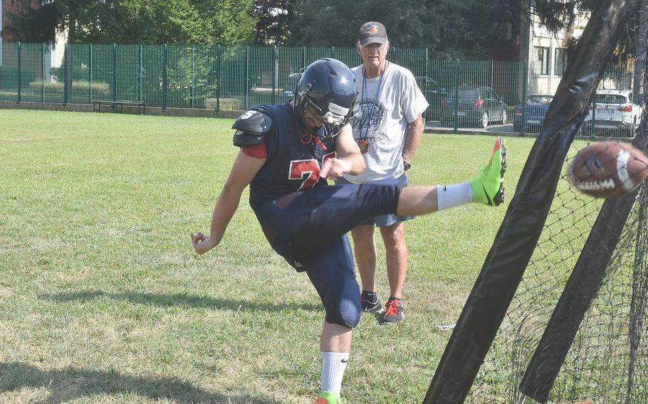 Aviano senior Giacomo Fabbro follows through on a kick in practice under the eyes of assistant coach Ken McNeely.