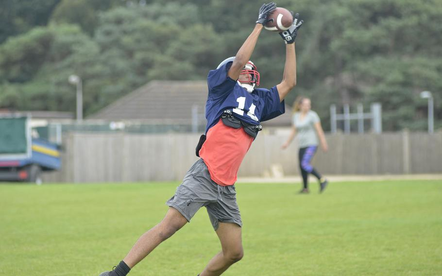Lancer football receiver Cam Franklin catches the ball while running a two-minute offense drill in a preseason practice at RAF Lakenheath, England, Tuesday, Aug. 14, 2018.