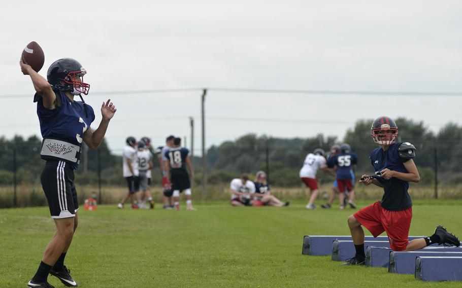 Rookie quarterback Anthony Smout runs a bootleg drill during Lancer football preseason practice at RAF Lakenheath, England, Tuesday, Aug. 14, 2018.