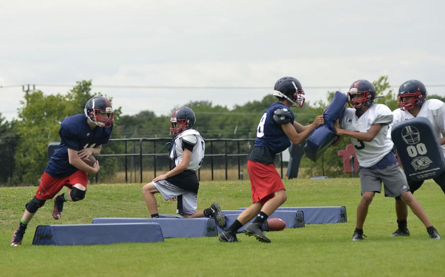 Lancer football players run drills during an afternoon preseason practice at RAF Lakenheath, England, Tuesday, Aug. 14, 2018. The Lancers have three new assistant coaches and a potential roster with 35 rookie and returning players this season.
