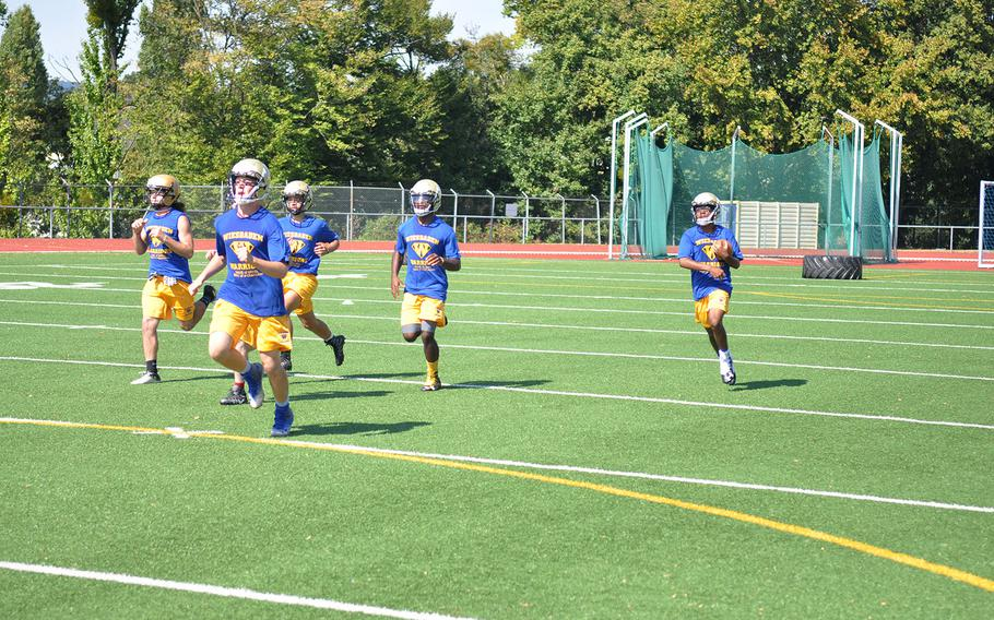 Wiesbaden players run a kickoff return drill at a preseason football practice session. The Warriors have a handful of returning contributors headlining a new group of players.
