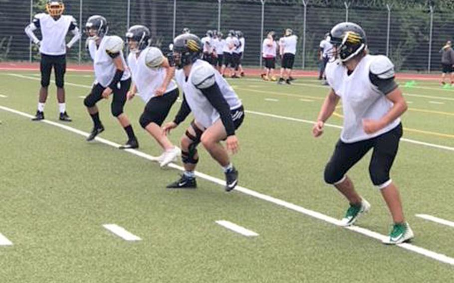 Stuttgart linebackers Gabe Flyte, Will Suddeth, Tyler McGrady, Garrett Sheffield and Cam Bochannek run drills at a recent Panther football practice. The Panthers are looking to be the first program to repeat as Division I football champion in more than a decade.