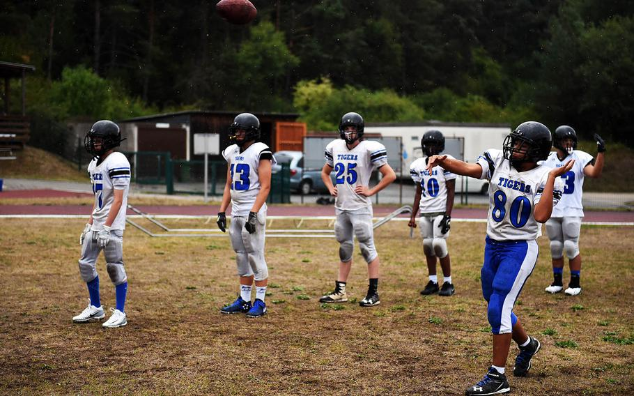 Hohenfels Tiger Anthony Gonzalez passes the footbal, during practice, Friday, Aug. 24, 2018.