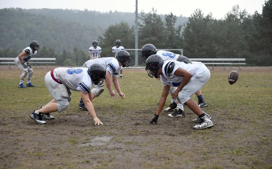 Hohenfels Tigers face each other as the ball is hiked, during practice, Friday, Aug. 24, 2018.