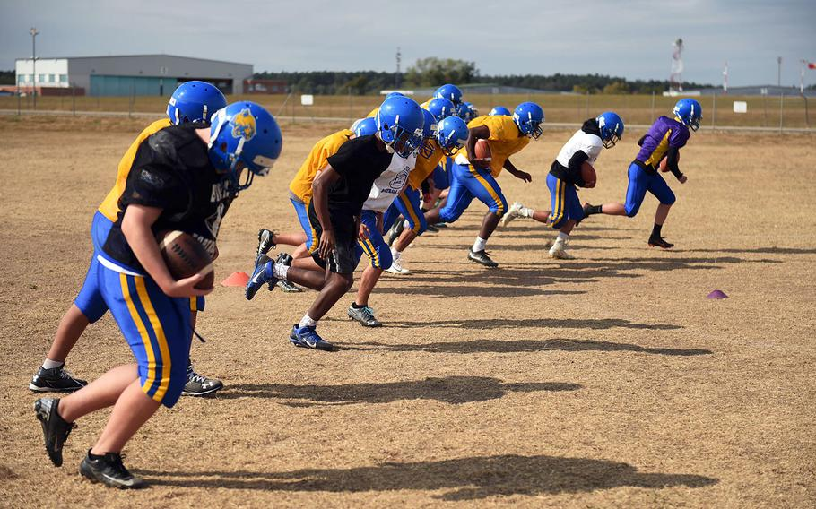The Ansbach Cougars run together during practice, Monday, August 27, 2018.
