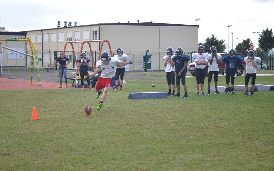 Kicker Dominic Fadden starts off a kickoff return drill in a Spangdahlem Sentinels preseason practice. The Sentinels expect to field a roster of 22 players, down from recent years but enough to avoid a drop to Division III six-man ball.