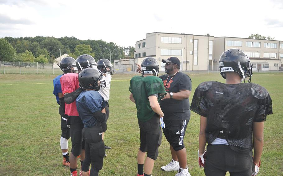 New Spangdahlem Sentinels head coach Chris Howard instructs a group of players in a preseason practice. Howard, the school's athletic director, is replacing Mike Laue, one of DODEA-Europe's most accomplished coaches.