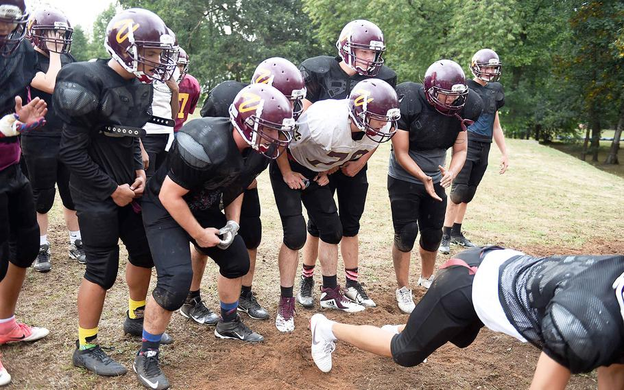 The Vilseck Falcons motivate each other during practice, Friday, Aug. 31, 2018, at Vilseck, Germany.
