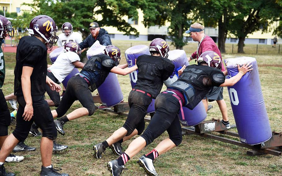 The Vilseck Falcons hit the sleds during practice, Friday, Aug. 31, 2018, at Vilseck, Germany.