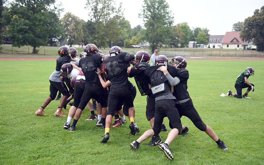 The Vilseck Falcons' offensive and deffensive lines clash during practice, Friday, Aug. 31, 2018, at Vilseck, Germany.