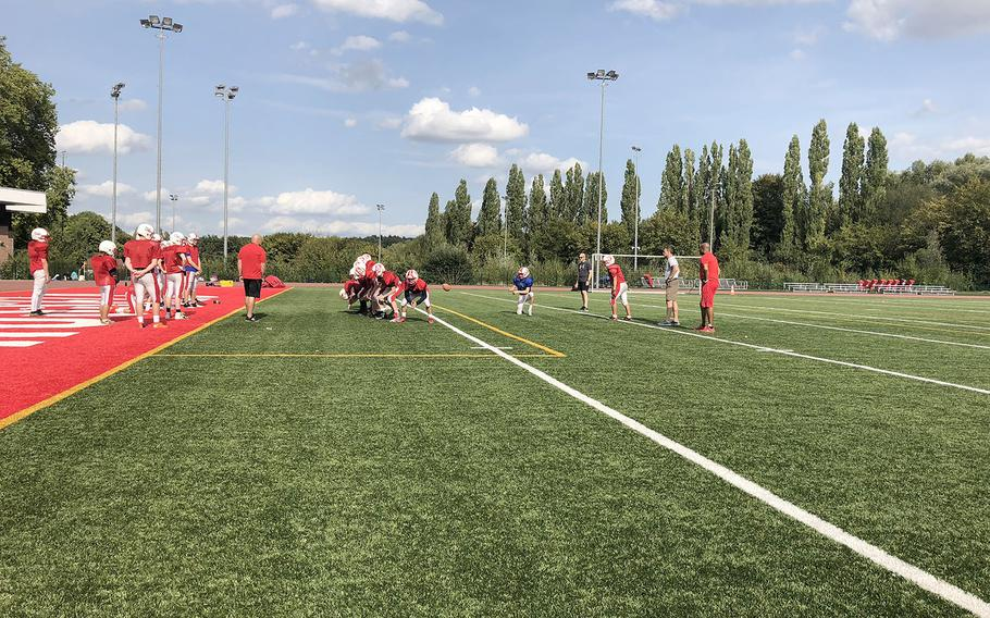 International School of Brussels conducts a drill at a preseason practice session. The Raiders open their regular season Saturday at Aviano.