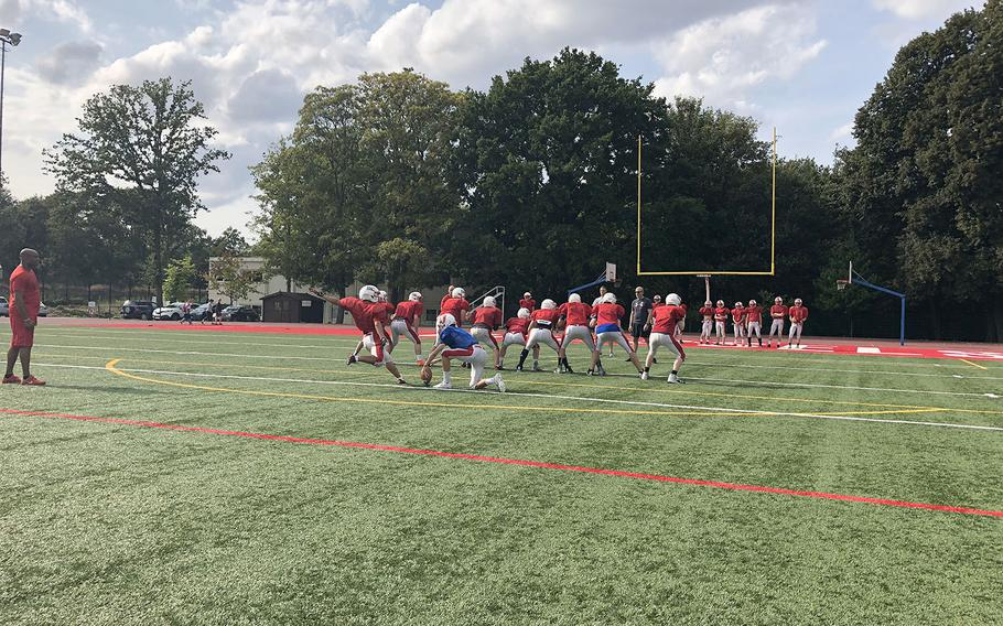 International School of Brussels players execute a kicking drill at a recent preseason practice. The Raiders are among seven teams in the mix for one of two DODEA-Europe Division II playoffs spots.