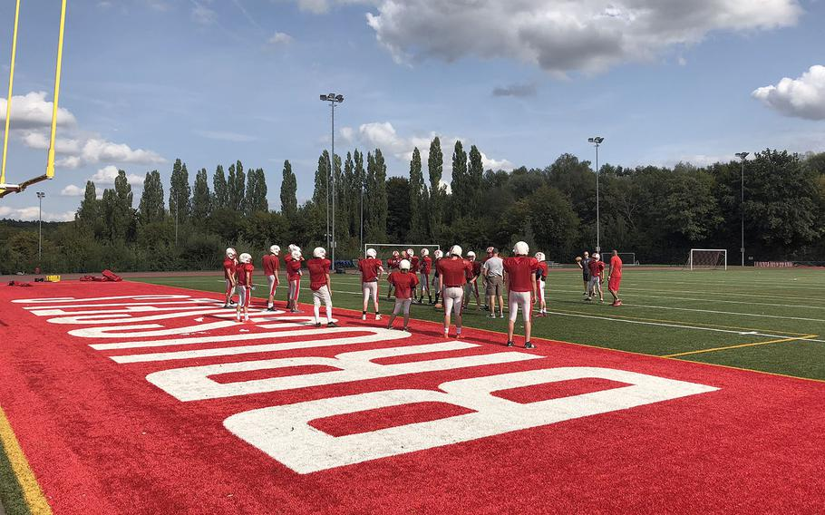 The International School of Brussels Raiders gather for a preseason practice session. The Raiders missed the playoffs last season despite a .500 overall and regional record.