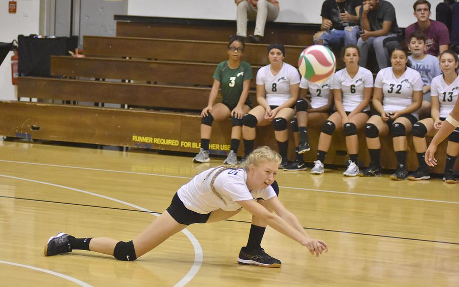 Naples' Roxanne Sasse saves a point by keeping the ball from striking the court and sending it up to an awaiting teammate on Friday, Sept. 14, 2018.