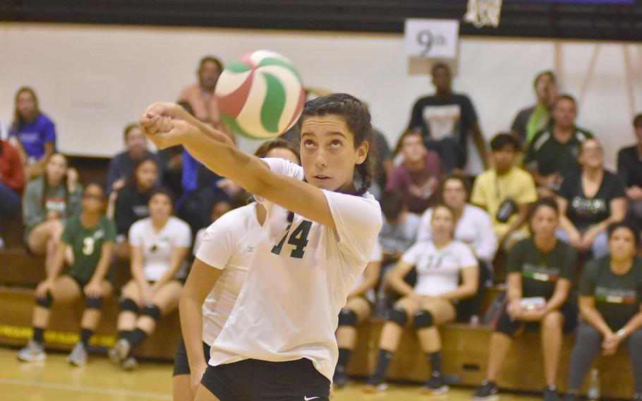 Naples' Lena Dieryckx bumps the ball during the Wildcats' volleyball matchup with Kaiserslautern on Friday, Sept. 14, 2018.