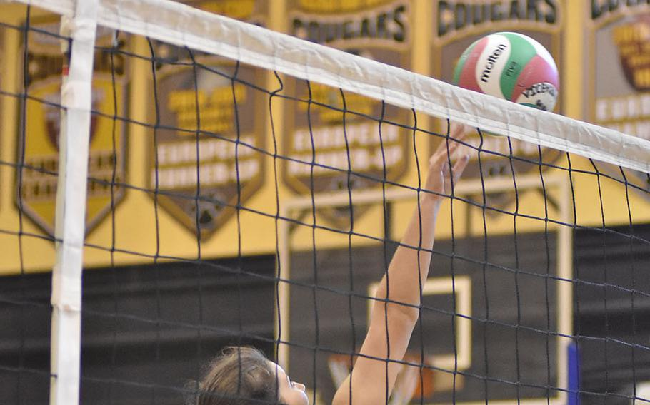 Vicenza's Julia Ridgley tips the ball over the net against Ramstein on Friday, Sept. 14, 2018.