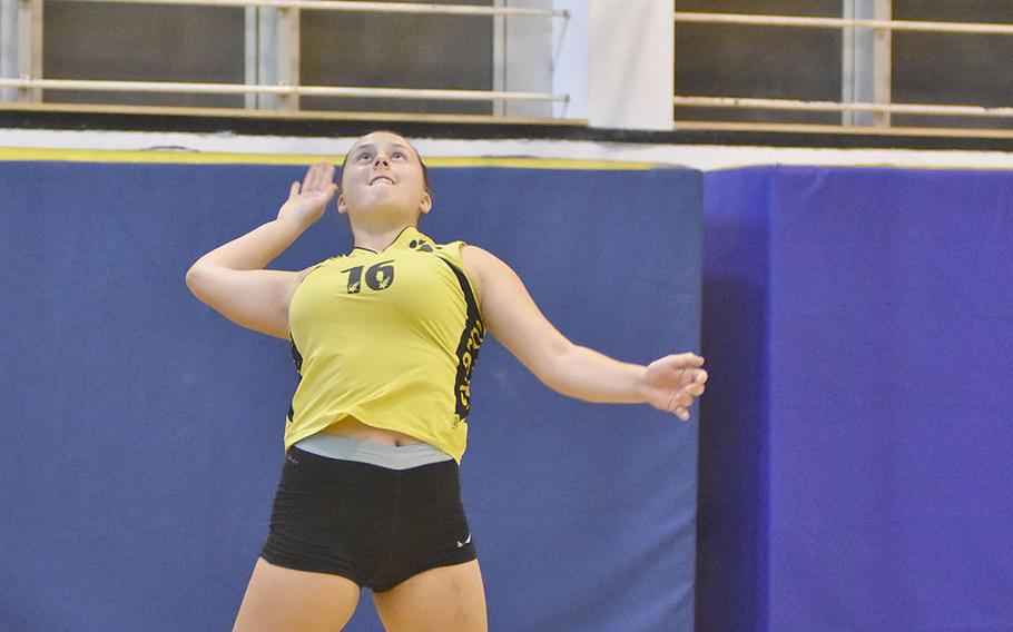 Vicenza libero Emelle Deck jumps to put the ball in play in the Cougars' 25-15, 25-23, 15-25, 18-25, 15-6 loss to Ramstein on Friday, Sept. 14, 2018.