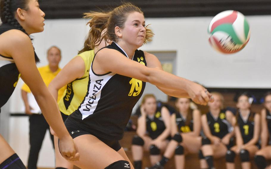 Vicenza's Madeline Mollner grimaces while digging a ball to start the Vicenza offense during the Cougars' 25-15, 25-23, 15-25, 18-25, 15-6 loss to Ramstein on Friday, Sept. 14, 2018.