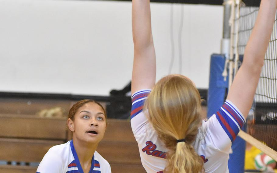 Ramstein's Masaya Archbold watches Izzy Coddington set the ball in the Royals' 25-15, 25-23, 15-25, 18-25, 15-6 victory over Vicenza on Friday, Sept. 14, 2018.