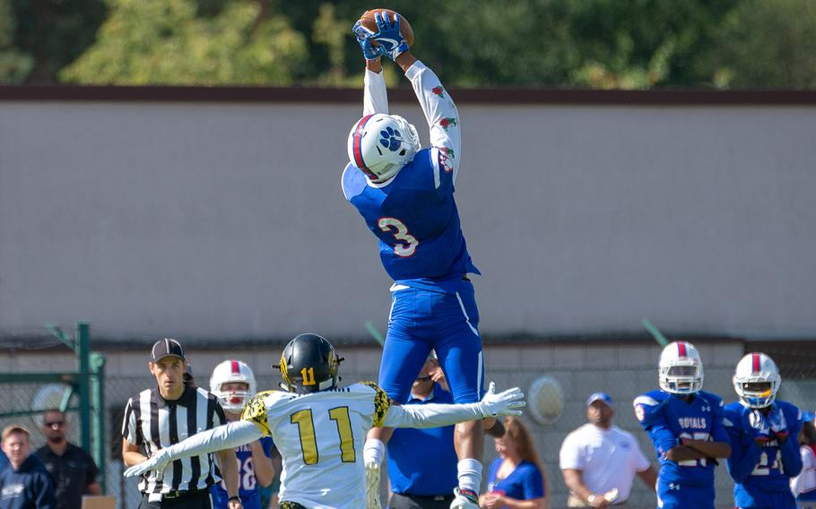 Naser Eaves leaps to catch a pass during the Ramstein vs Stuttgart football game Saturday, Sept. 15, 2018.  Ramstein won the game 41-19.