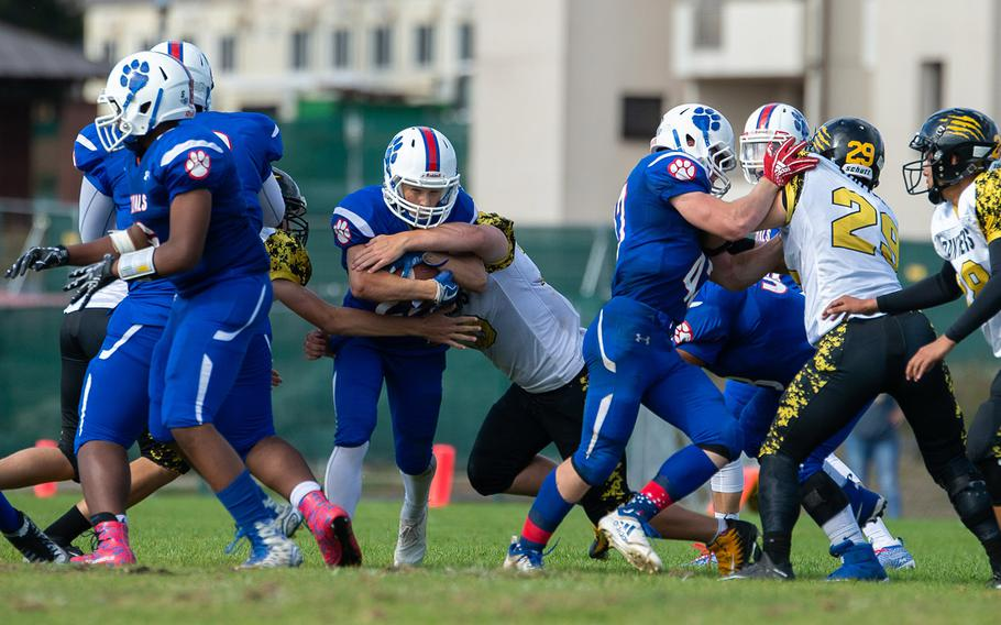 Oliver Seelig, 22, charges though the line of scrimmage to pick up a few yards during the Ramstein vs Stuttgart football game Saturday, Sept. 15, 2018.  Ramstein won the game 41-19.