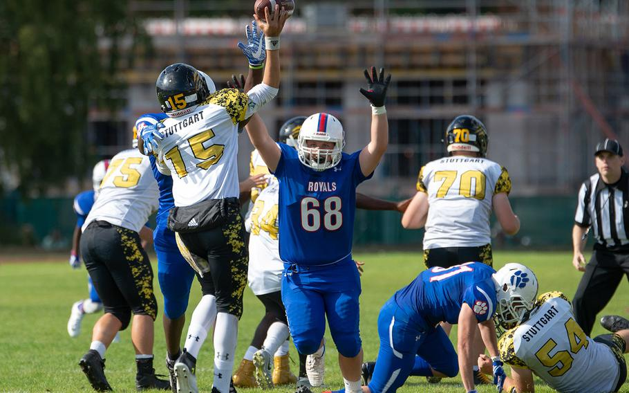Alec Kenfield throws a screen pass wile under pressure during the Ramstein vs Stuttgart football game Saturday, Sept. 15, 2018.  Ramstein won the game 41-19.