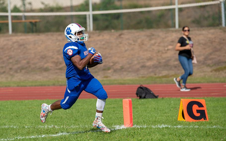 Dominque Arizpe crosses the goal line during the Ramstein vs Stuttgart football game Saturday, Sept. 15, 2018.  Ramstein won the game 41-19.
