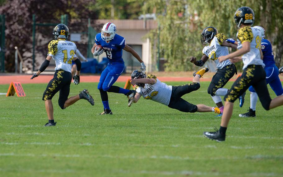 Jason Jones Jr. breaks a tackle as he runs for the first down during the Ramstein vs Stuttgart football game Saturday, Sept. 15, 2018.  Ramstein won the game 41-19.