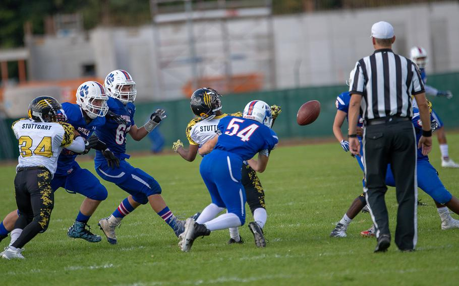 Cole Storm causes a fumble during the Ramstein vs Stuttgart football game Saturday, Sept. 15, 2018.  Ramstein won the game 41-19.