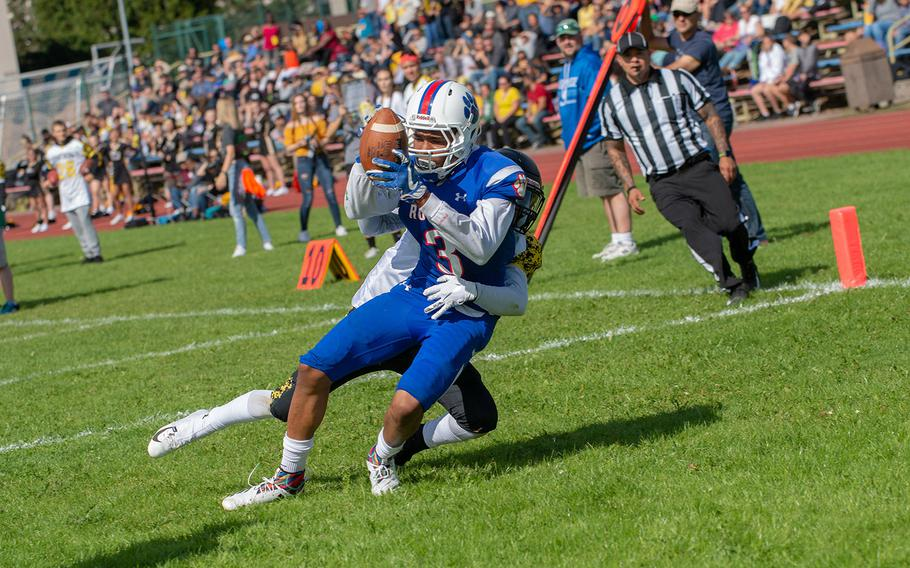 Nader Eaves catches a touchdown pass during the Ramstein vs Stuttgart football game Saturday, Sept. 15, 2018.  Ramstein won the game 41-19.