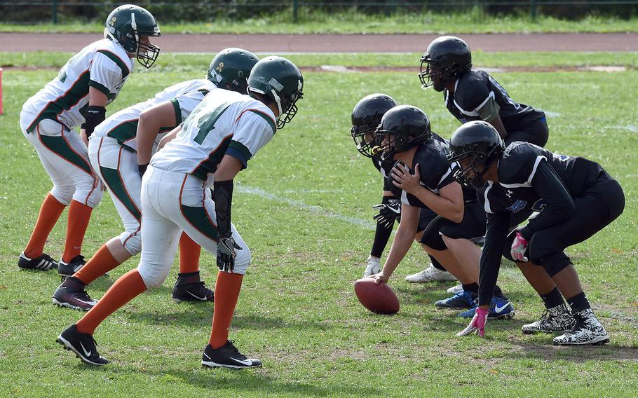 The Hohenfels Tigers prepare to hike the ball as they face off against the AFNORTH Lions during a game at Hohenfels, Germany, Saturday, Sept. 22, 2018.