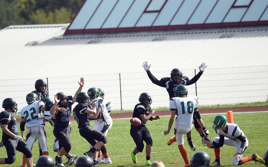 AFNORTH's Alan Goldsmith kicks the ball for an extra two points while the Hohenfels Tigers try to block it, during a game at Hohenfels, Germany, Saturday, Sept. 22, 2018.