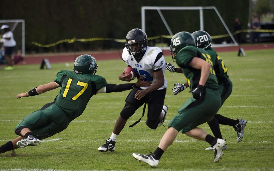 The Alconbury defense converges on a Hohenfels ball carrier in a 2014 DODEA-Europe football game. Alconbury and Sigonella opted not to participate in Division III football in 2018, but are considering it for future seasons.