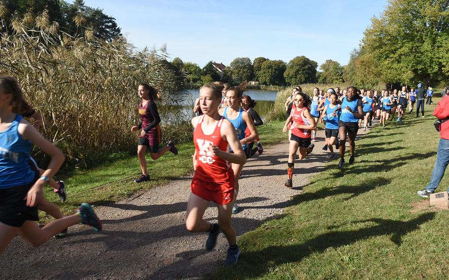 Kaiserslautern's Chloe Martin races towards the front of the pack at the start of the Ramstein cross country meet on Saturday, Sept. 29, 2018, in Miesenbach, Germany.