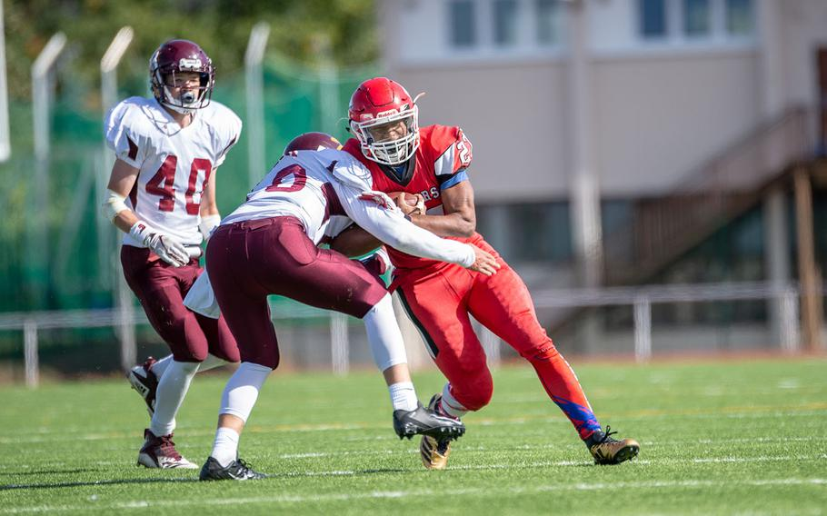 Corey Coombs is hit during the Kaiserslautern vs. Vilseck high school football game in Kaiserslautern, Germany, Saturday Sept. 29, 2018.  Kaiserslautern won the game 26-20