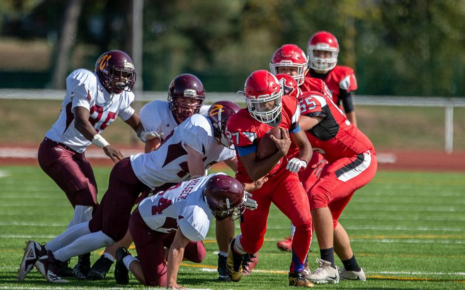 Corey Coombs breaks a tackle during the Kaiserslautern vs. Vilseck high school football game in Kaiserslautern, Germany, Saturday Sept. 29, 2018.  Kaiserslautern won the game 26-20