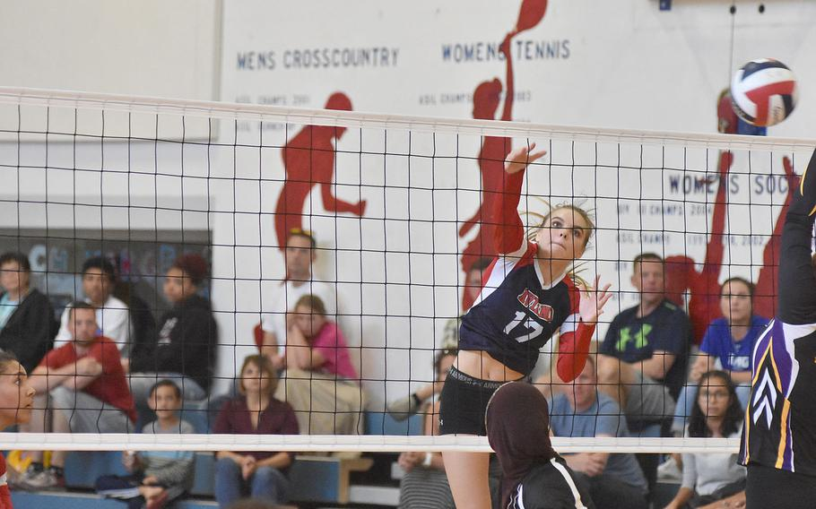 Aviano's Ashley Woodruff spikes the ball during the Saints' sweep of Baharain on Saturday in Italy.