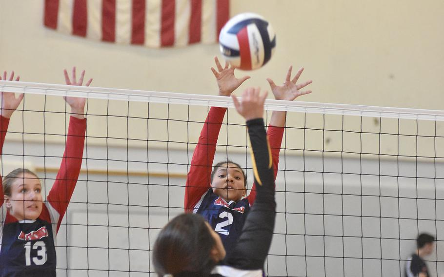 Bahrain's Sahar Nangoli  tries to get the ball past Aviano blockers Sam Kandle, left, and Baylee Kindrick during hte Saints' victory on Saturday.