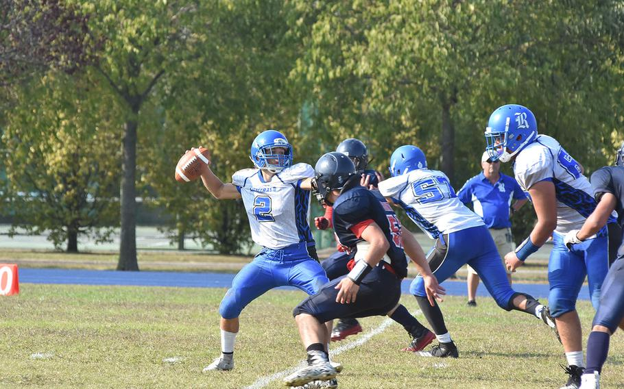 Rota quarterback Wesley Penta braves the Aviano pass rush to attempt to attempt a pass Saturday in the Saints' 22-14 victory.
