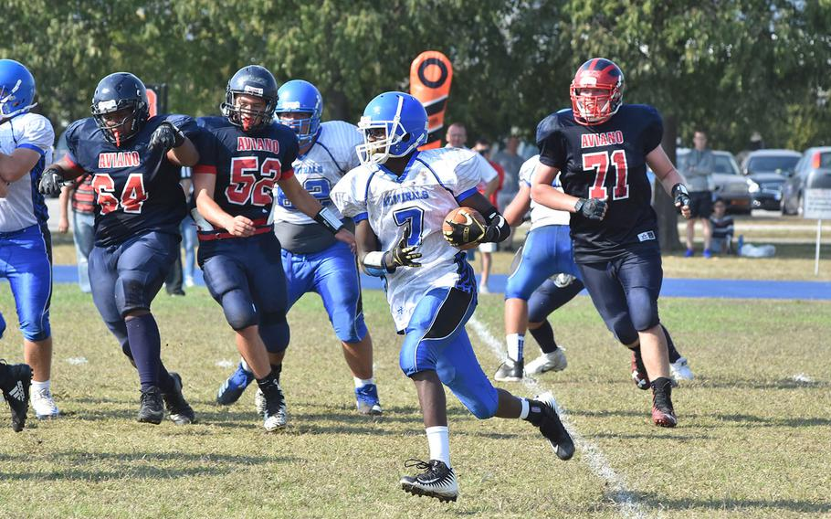 Rota's LJ Chester carries the ball on an end around in the Admirals' 22-14 loss to Aviano on Saturday, Sept. 29, 2018.