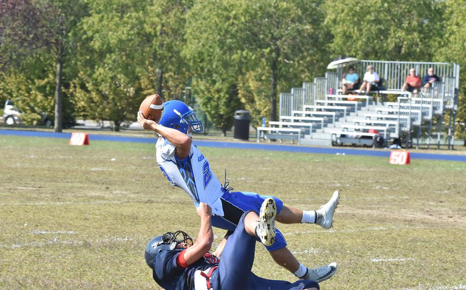 Aviano's Kohl Mattes sacks Rota quarterback Wesley Penta before he gets rid of the ball in the Saints' 22-14 victory on Saturday.