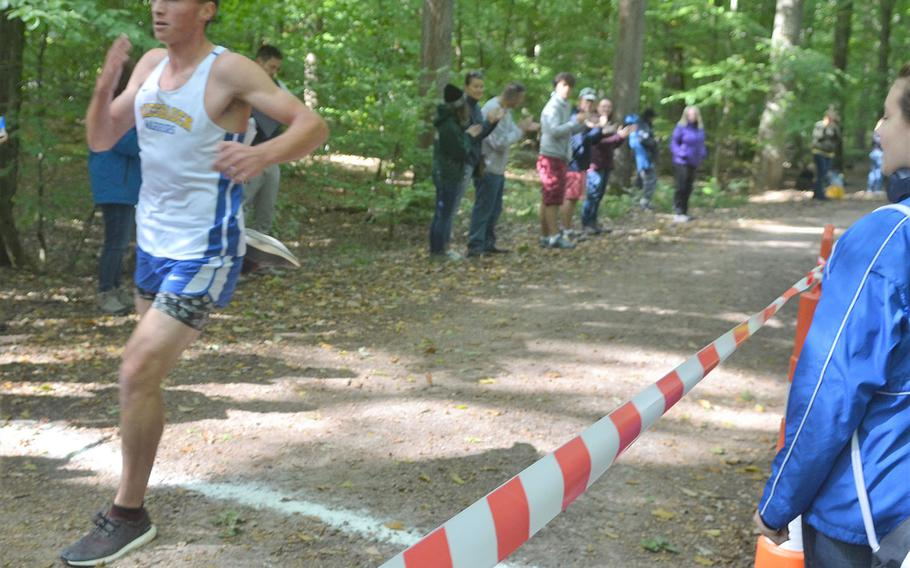 Roberto Eiseman, a Wiesbaden senior, crosses the finish line in first place on Saturday, Sept. 29, 2018. The race was the first home meet for the Warriors.