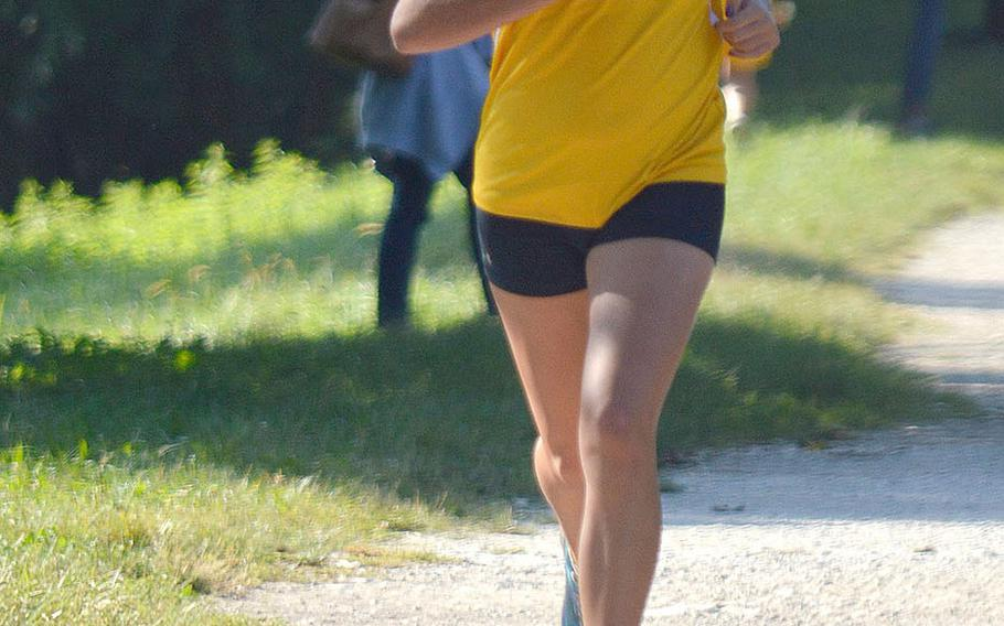 Olivia Martel, a sophomore at Vicenza, crosses the finish line at a 5-kilometer race that took place at Lago Di Fimon, Vicenza, Italy, on Saturday, Sept. 29. She finished in second with a time of 21 minutes and 37 seconds - 1 and a half minutes faster than her last best finish.