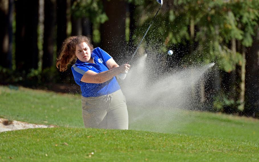 Ramstein's Lauren Sutherland hits out of a bunker  on the first day of competition at the DODEA-Europe golf championships at Rheinblick golf course in Wiesbaden, Germany, Wednesday, Oct. 10, 2018.
