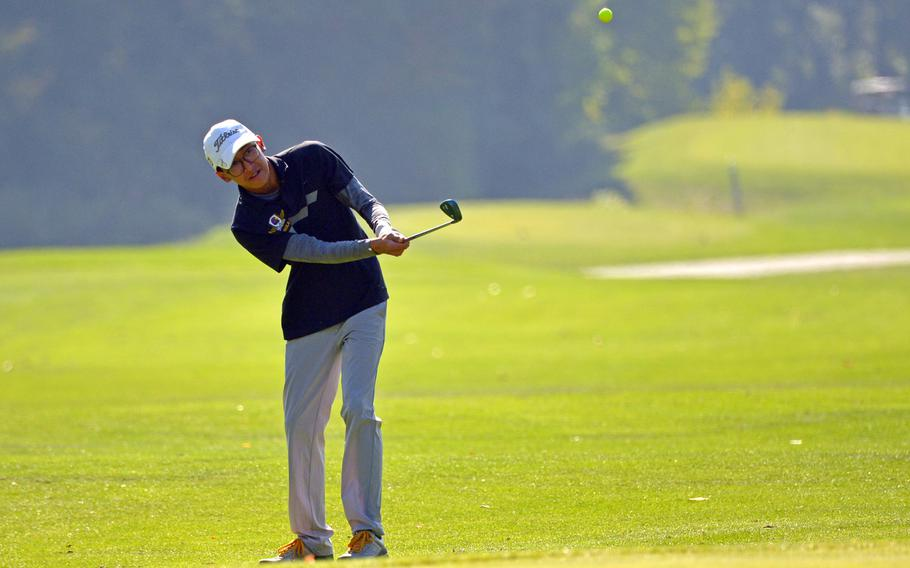 Bahrain's Faris Mohd-Ghazali hits to the green on the first day of competition at the DODEA-Europe golf championships at Rheinblick golf course in Wiesbaden, Germany, Wednesday, Oct. 10, 2018.