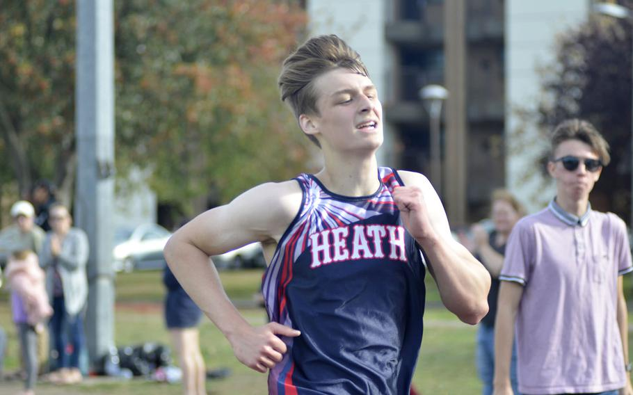 Lakenheath's Sean Marts strides towards the finish of a 5-kilometer race during a high school cross country meet at RAF Lakenheath, England, Saturday, Oct. 13, 2018. Marts earned third place with a time of 18 minutes and 13 seconds.