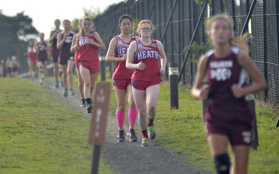 High school cross country runners from Lakenheath, Alconbury, Vilseck and Spangdahlem in the first lap of a 5-kilometer race at RAF Lakenheath, England, Saturday, Oct. 13, 2018. The Lancers earned the top three finishing times with Hollie Myers at 21 minutes, 34 seconds, Annie Roundy at 22:10 and Jenna Bills at 22:56.