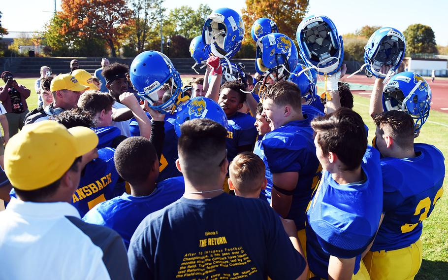 The Ansbach Cougars celebrate after a win against the Brussels Brigands during a game at Ansbach, Germany, Saturday, Oct. 13, 2018.
